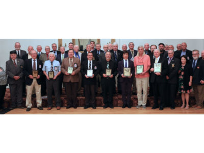 A photo of the 2019 World Drum Corps Hall of Fame Inductees.
